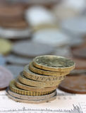 Monedas en la página del negocio Fotografía de archivo libre de regalías
