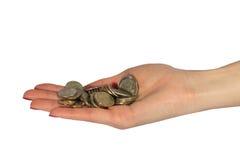 Monedas en la palma Imagen de archivo libre de regalías