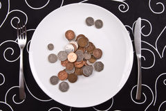Monedas en la placa Fotos de archivo libres de regalías