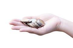 Monedas en las manos aisladas en blanco Fotos de archivo libres de regalías
