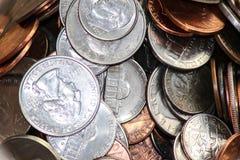 Monedas en tarro Imágenes de archivo libres de regalías