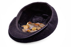 Monedas en un casquillo Fotos de archivo