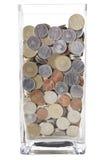Monedas en un florero Imágenes de archivo libres de regalías