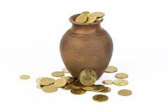 Monedas en un pote Fotos de archivo