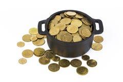 Monedas en un pote Imágenes de archivo libres de regalías