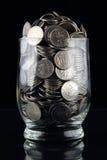 Monedas en vidrio Imágenes de archivo libres de regalías