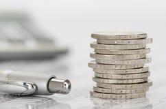Monedas euro apiladas en la hoja de la tabla Fotografía de archivo libre de regalías
