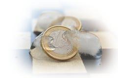Monedas euro de congelación Imágenes de archivo libres de regalías