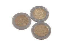 Monedas euro en un fondo blanco llano Imágenes de archivo libres de regalías