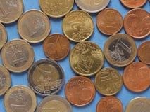 Monedas euro, unión europea sobre azul Fotos de archivo libres de regalías