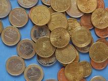 Monedas euro, unión europea sobre azul Imagen de archivo