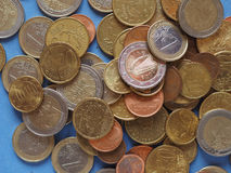 Monedas euro, unión europea sobre azul Imagenes de archivo