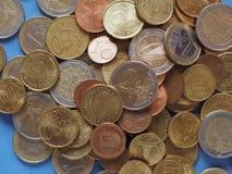Monedas euro, unión europea sobre azul Fotografía de archivo