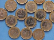 Monedas euro, unión europea sobre azul Foto de archivo