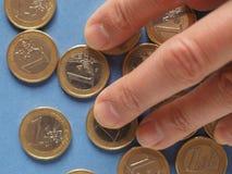 Monedas euro, unión europea sobre azul Imágenes de archivo libres de regalías