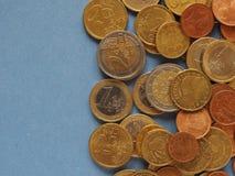 Monedas euro, unión europea sobre azul con el espacio de la copia Imágenes de archivo libres de regalías