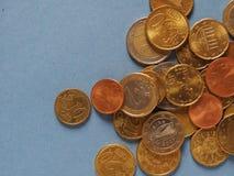 Monedas euro, unión europea sobre azul con el espacio de la copia Foto de archivo libre de regalías