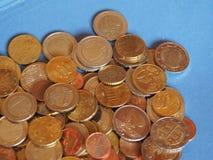 Monedas euro, unión europea sobre azul con el espacio de la copia Imagen de archivo libre de regalías