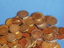 Monedas euro, unión europea sobre azul con el espacio de la copia Fotografía de archivo