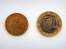 Monedas griegas del dracma y del euro Imagen de archivo libre de regalías