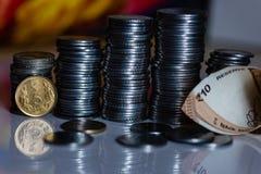 Monedas indias de la moneda apiladas fotografía de archivo