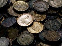Monedas inglesas viejas Imágenes de archivo libres de regalías