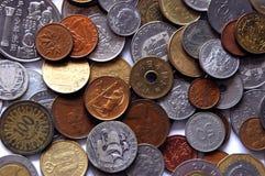 Monedas internacionales imagen de archivo
