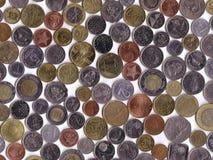 Monedas internacionales Fotografía de archivo