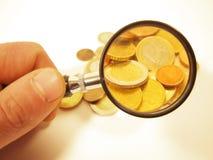 Monedas magnificadas Imágenes de archivo libres de regalías