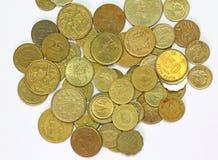 Monedas mezcladas internacionales foto de archivo