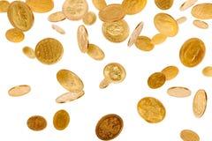 Monedas que caen Foto de archivo libre de regalías