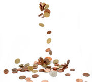 Monedas que caen imagen de archivo libre de regalías