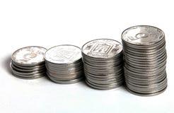 Monedas que crecen concepto Fotos de archivo libres de regalías
