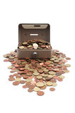 Monedas que desbordan seguras foto de archivo libre de regalías