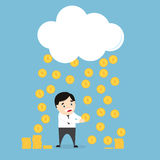 Monedas que llueven sobre un hombre de negocios Imagen de archivo libre de regalías