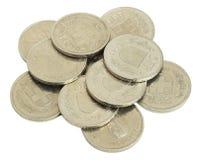 Monedas suizas en el fondo blanco Fotografía de archivo