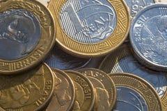 Monedas verdaderas fotografía de archivo libre de regalías