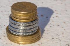 Monedas verdaderas fotos de archivo