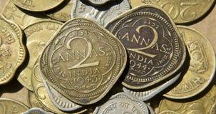 Monedas viejas de británicos la India Imágenes de archivo libres de regalías