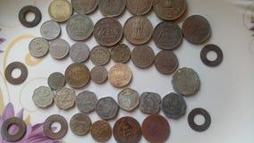Monedas viejas indias fotos de archivo
