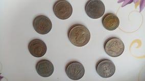 Monedas viejas indias imagen de archivo