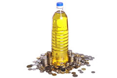 Monedas y aceite de cocina Fotografía de archivo libre de regalías