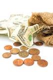 Monedas y arrugado un billete de dólar en el fondo blanco Imagen de archivo libre de regalías