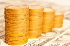Monedas y billete de banco Fotografía de archivo libre de regalías