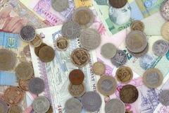 Monedas y billetes Imagen de archivo