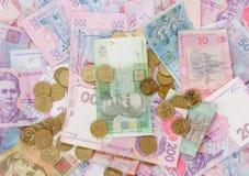 Monedas y billetes de banco Fotos de archivo libres de regalías