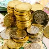 Monedas y billetes de banco Imagenes de archivo