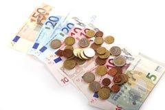 Monedas y billetes de banco de Euros Money Imagen de archivo libre de regalías