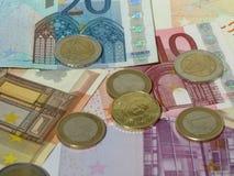Monedas y billetes euro Fotografía de archivo libre de regalías
