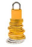 Monedas y bloqueo foto de archivo libre de regalías